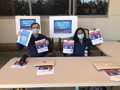 Medical students helped patients register to vote and request absentee ballots in a voting initiative.