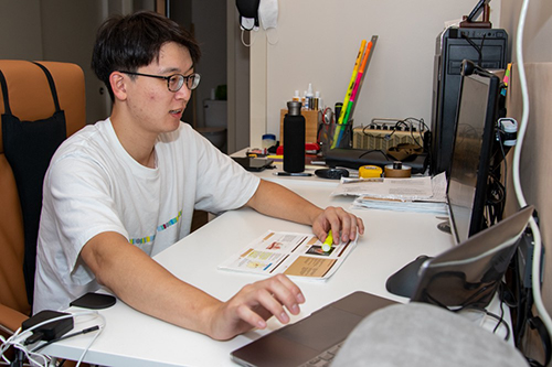 First-year medical student Sung Jik Cha studies at his home office outfitted with a large desk where he can watch lectures and spread out his papers.